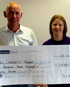 Paul McQuillan, Armagh City , Banbridge and Craigavon Borough Council, presenting a cheque to NI Children's Hospice.